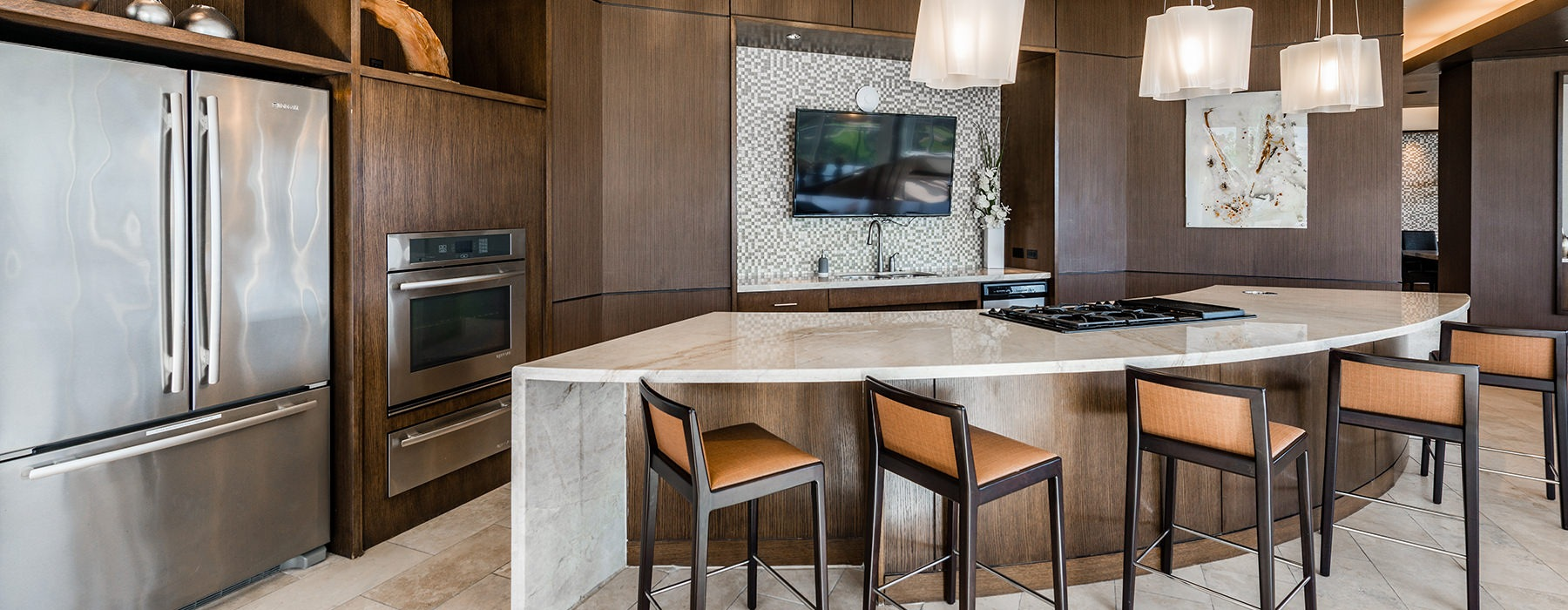 Spacious and well lit demo kitchen with all stainless steel appliances